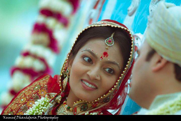 A beautiful glance of the bride! by Kumud Dhandharia Photography Wedding-photography | Weddings Photos & Ideas