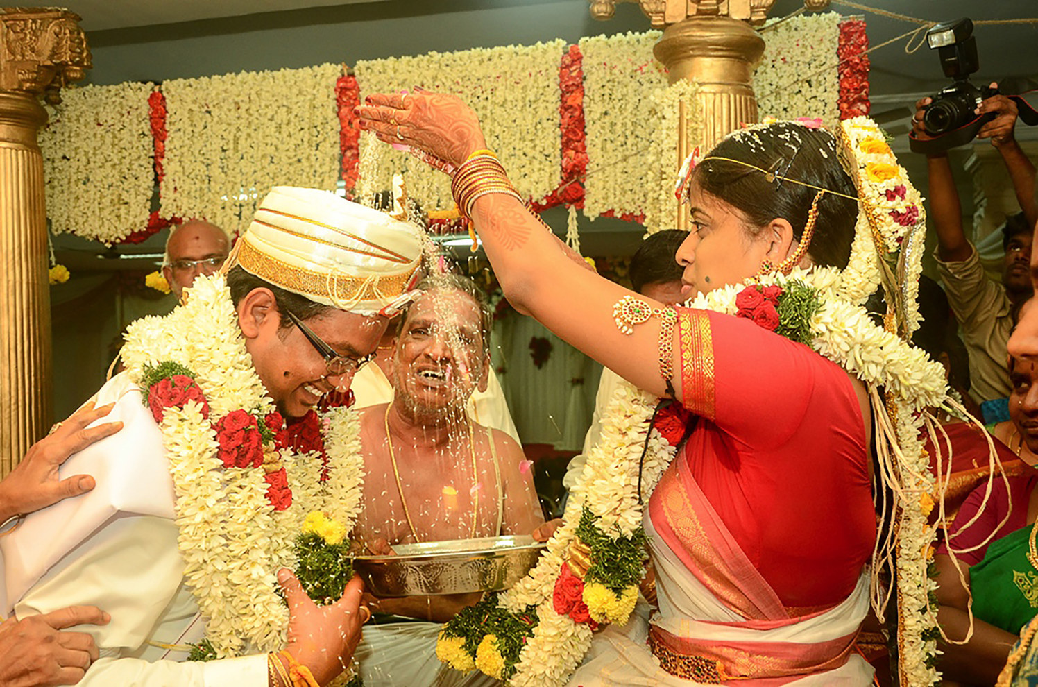 A stunning couple performing a ritual! by Vinod VV Photography Wedding-photography | Weddings Photos & Ideas