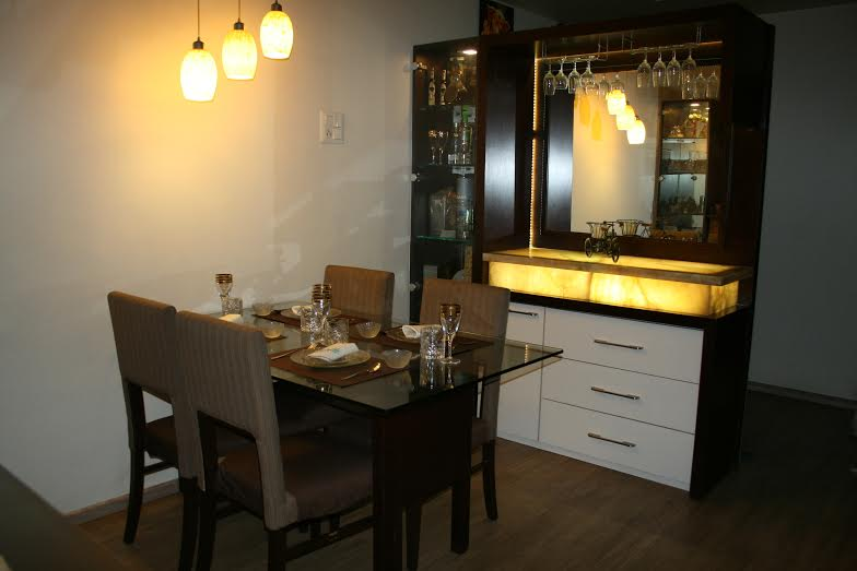 The dining table with home bar beside by E- Studio Traditional | Interior Design Photos & Ideas