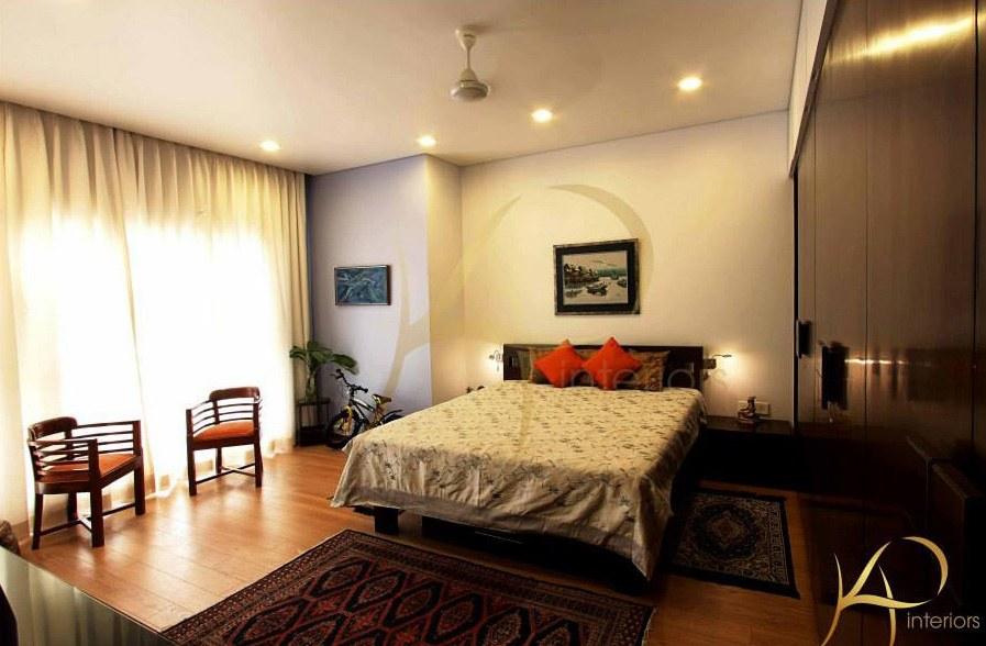Bedroom With Orange Pillows by KP Interior Bedroom Contemporary | Interior Design Photos & Ideas