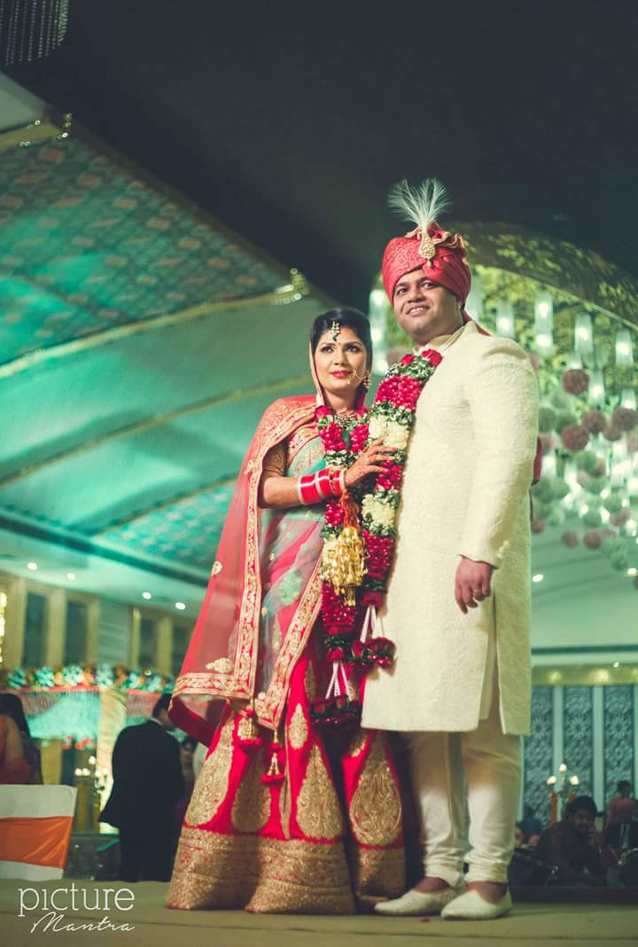 The married couple looking picture perfect in their attire by PictureTree Wedding-photography | Weddings Photos & Ideas
