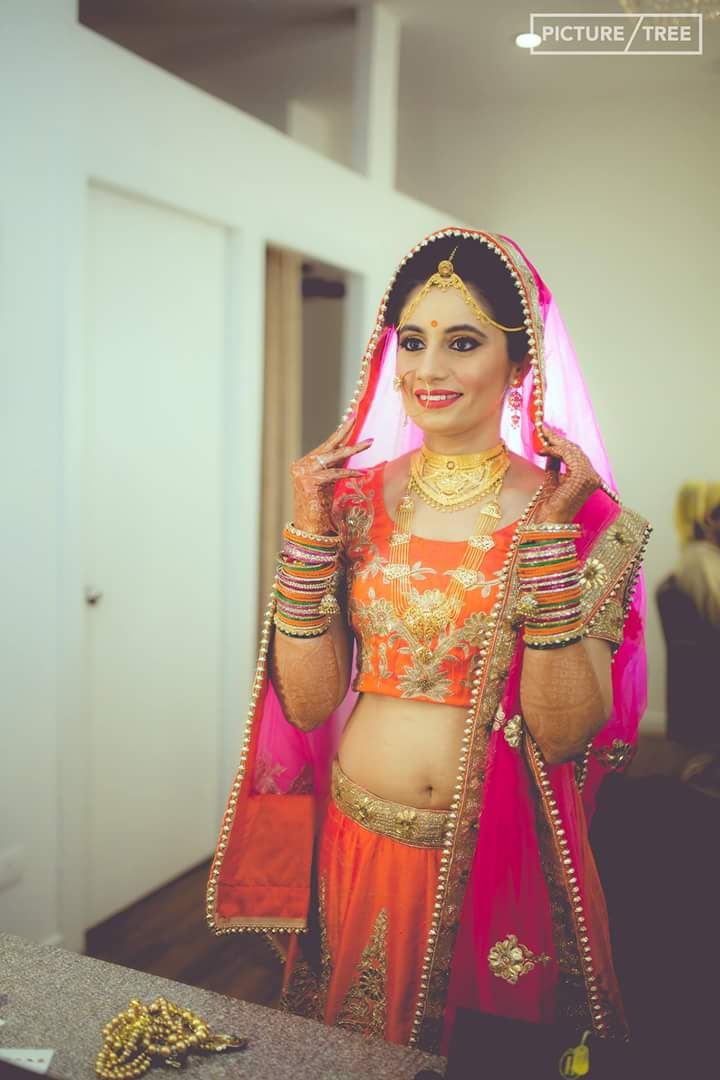The bride looking stunning in her pretty pink lehenga by PictureTree Wedding-photography | Weddings Photos & Ideas