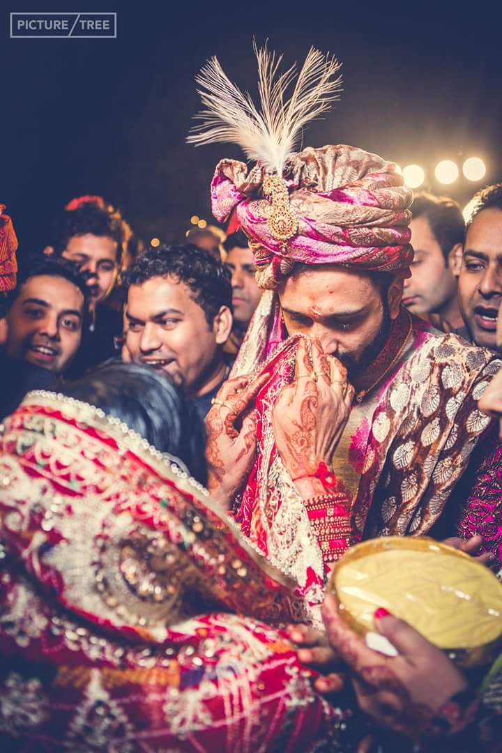 A candid photo of the groom involved in wedding rituals by PictureTree Wedding-photography | Weddings Photos & Ideas