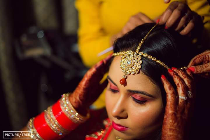 The bride shining wearing her extravagant maang tikka by PictureTree Wedding-photography | Weddings Photos & Ideas