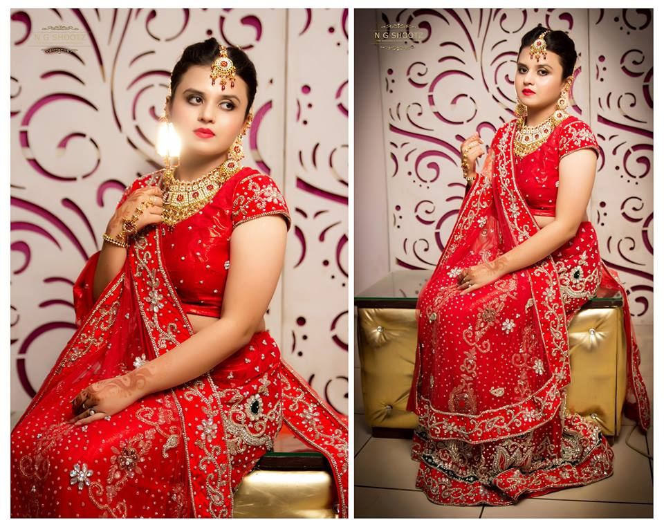 The bride posing in her beautiful red lehenga by NG Shootz Wedding-photography | Weddings Photos & Ideas