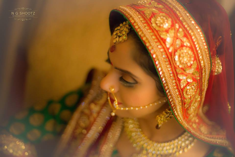 An overhead shot of the bride wearing her elegant maang tikka by NG Shootz Wedding-photography | Weddings Photos & Ideas