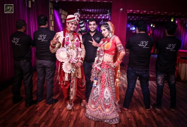 The ecstatic couple posing with the photographer by NG Shootz Wedding-photography | Weddings Photos & Ideas
