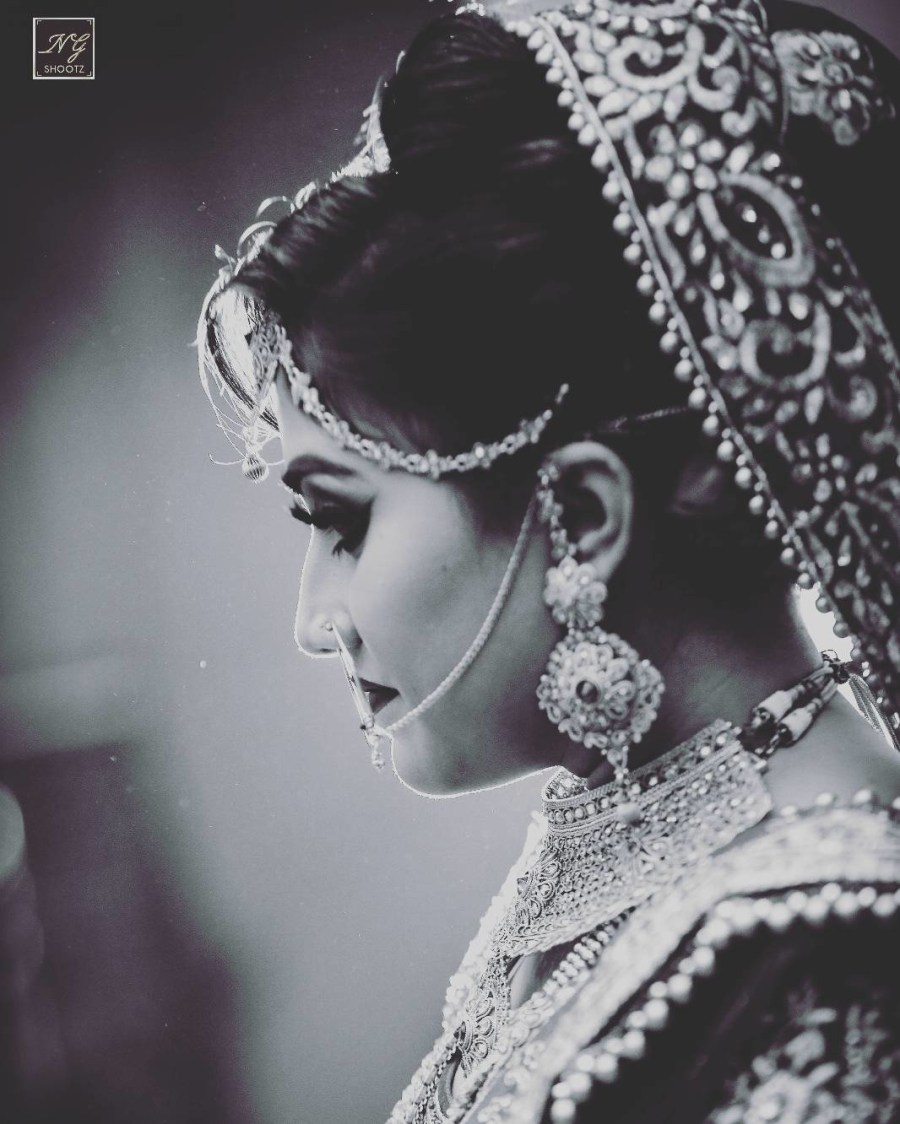 The brides classy earrings suiting her well by NG Shootz Wedding-photography | Weddings Photos & Ideas