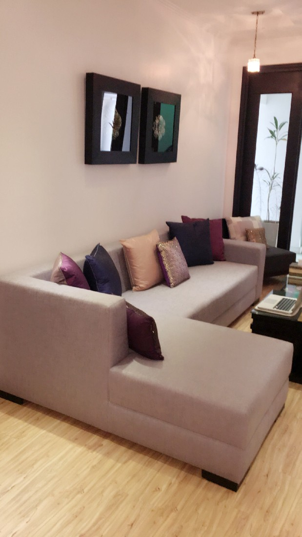 Beige Sectional Sofa and Light Brown Shaded Wooden Vinyl Floor by Sakshi Gugnani Living-room Modern | Interior Design Photos & Ideas
