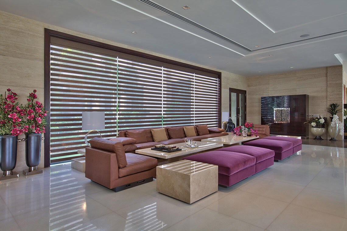 Spacious Living Room With Blush Pink Leather Sofas by Sakshi Gugnani Living-room Modern | Interior Design Photos & Ideas