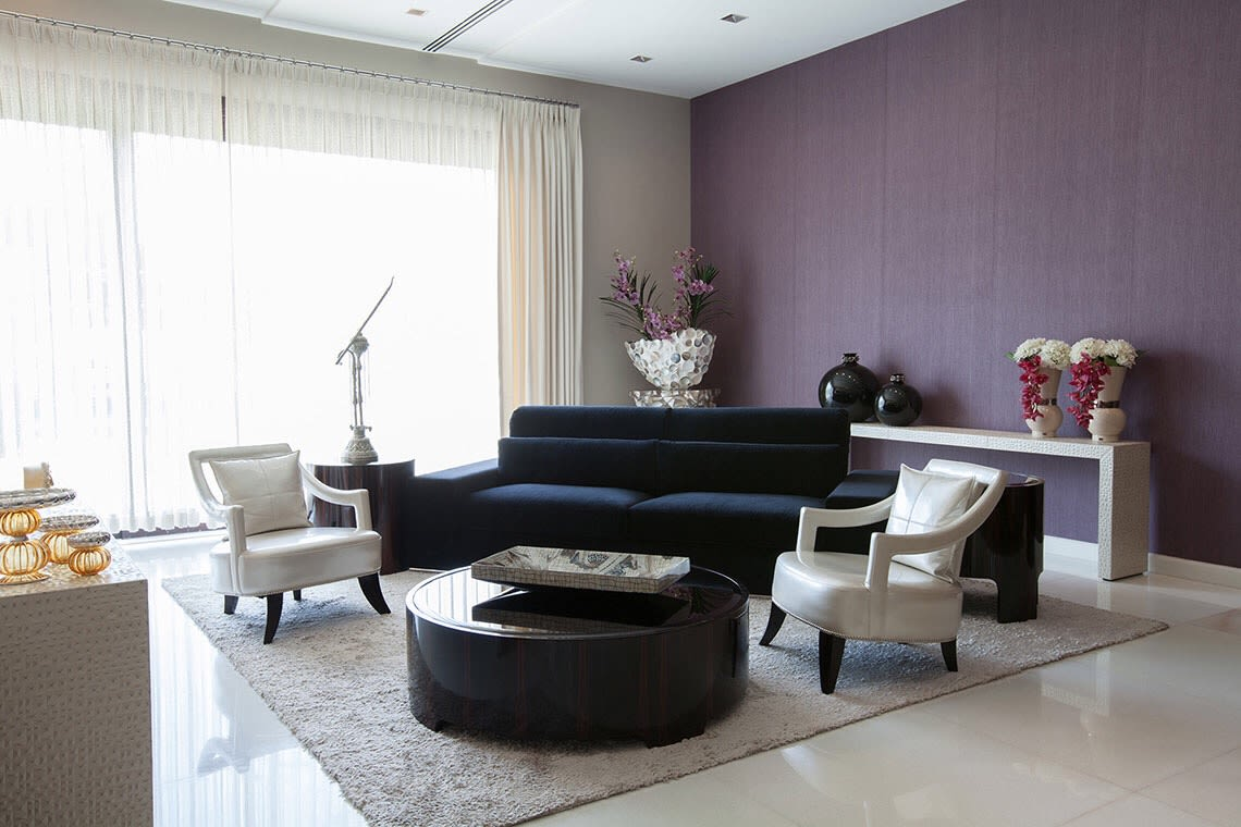 Contrasting Living Room Space With Black Mid-Century Modern Sofa by Sakshi Gugnani Living-room Modern | Interior Design Photos & Ideas