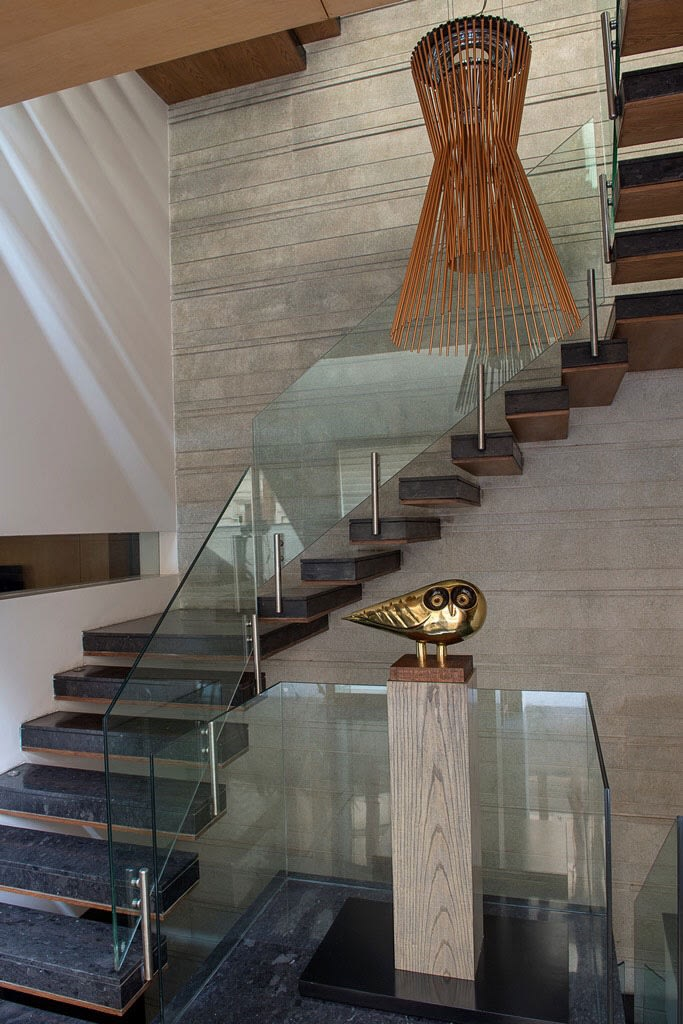 Stairway With Black  Granite Floor and Glass Enclosures by Sakshi Gugnani Indoor-spaces Modern | Interior Design Photos & Ideas
