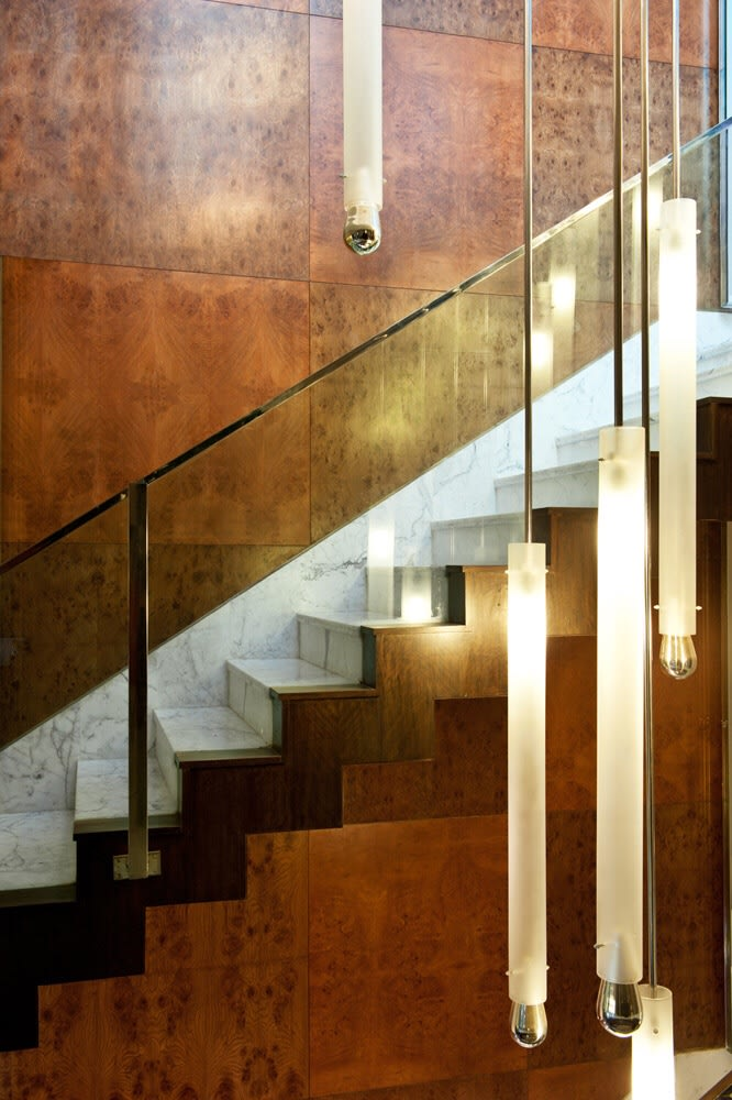 Wooden Staircase With Glass Enclosure and Sleek  Hanging Pendant Lamps by Sakshi Gugnani Indoor-spaces Modern | Interior Design Photos & Ideas