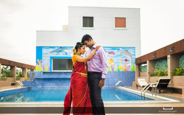 Poolside shot of the stellar couple by Chiaroscuro Wedding and Art Studio Wedding-photography | Weddings Photos & Ideas