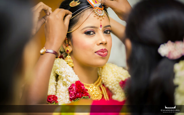 The bride making sure her maang tikka is perfect by Chiaroscuro Wedding and Art Studio Wedding-photography | Weddings Photos & Ideas