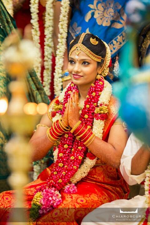 The bride with an elegant namaste by Chiaroscuro Wedding and Art Studio Wedding-photography | Weddings Photos & Ideas