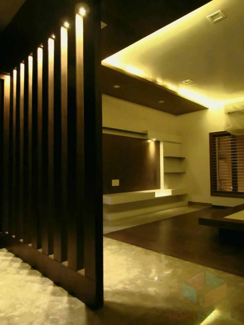 Master bedroom with wooden flooring by Noah Interiors  Bedroom Modern | Interior Design Photos & Ideas