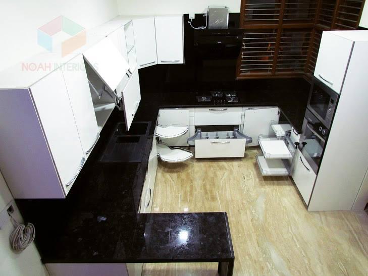 Modular L shaped kitchen with wooden flooring by Noah Interiors  Modular-kitchen Modern | Interior Design Photos & Ideas