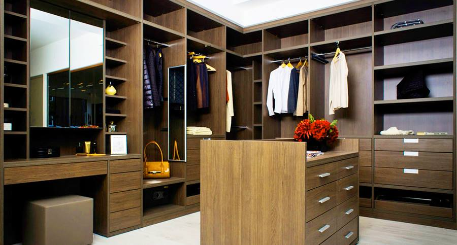 Walk in wooden closet with center desk and base drawers by Interior Wizards Dining-room Modern | Interior Design Photos & Ideas