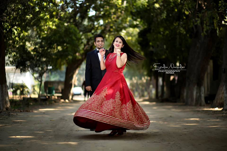 Stunning Red A-Line Gown With Golden Border Lines And Prints by Sourab Sharma Wedding-photography Wedding-dresses | Weddings Photos & Ideas