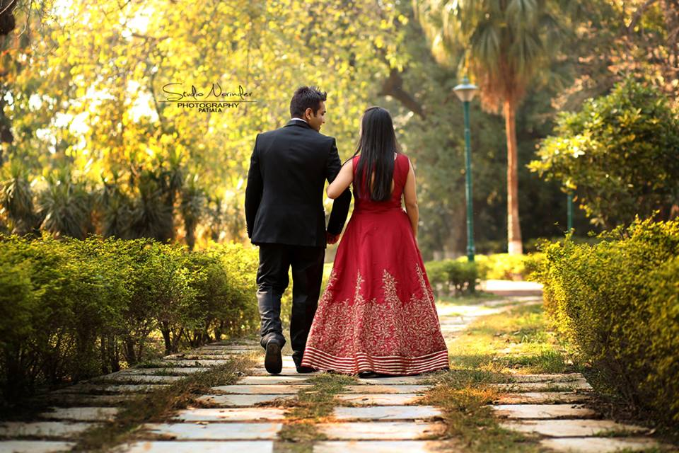 Back Shot Of The Couple Taking A Brisk Walk In A Park by Sourab Sharma Wedding-photography | Weddings Photos & Ideas