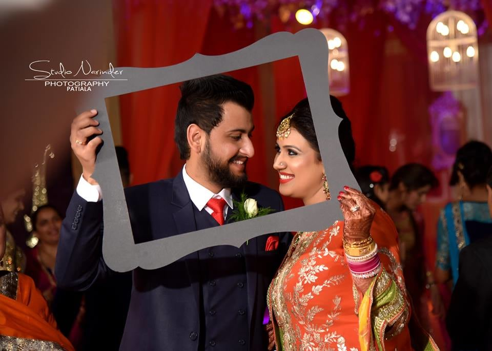 Conventional Punjabi Couple Holding A Black Curved Frame For Wedding Shoot by Sourab Sharma Wedding-photography | Weddings Photos & Ideas