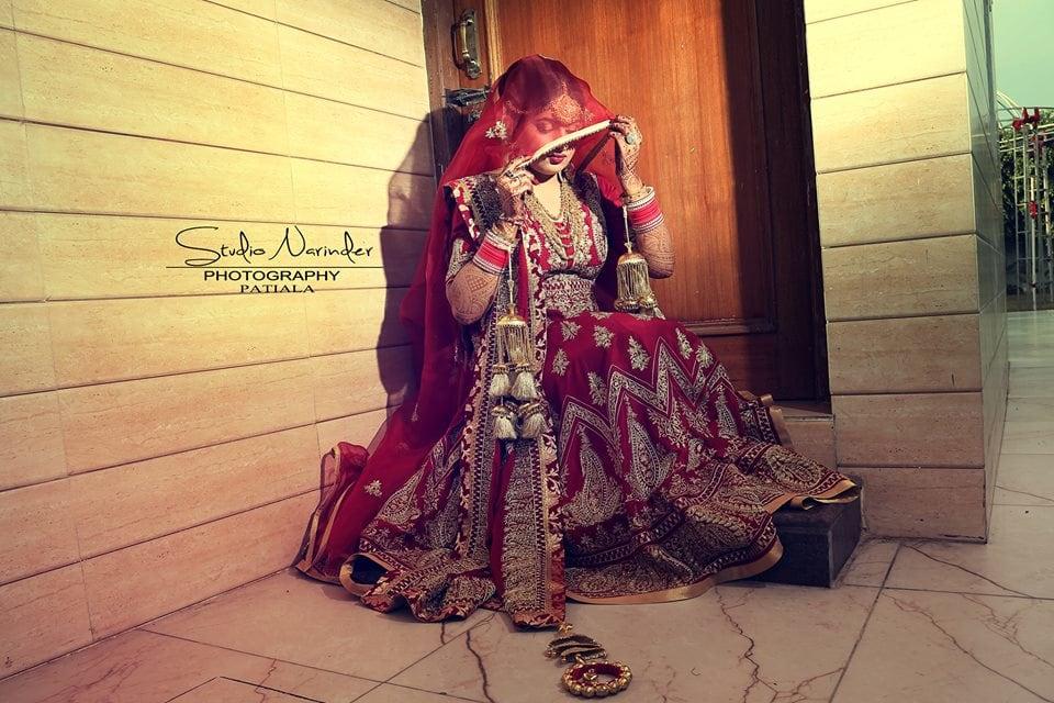 Regal Cherry Red Lehenga With Detailed Golden Motifs by Sourab Sharma Wedding-photography Wedding-dresses   Weddings Photos & Ideas