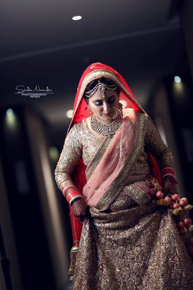 Shimmering Golden Lehenga With Soft Pink Chunni Completing Its Look With Red Veil by Sourab Sharma Wedding-photography Wedding-dresses | Weddings Photos & Ideas