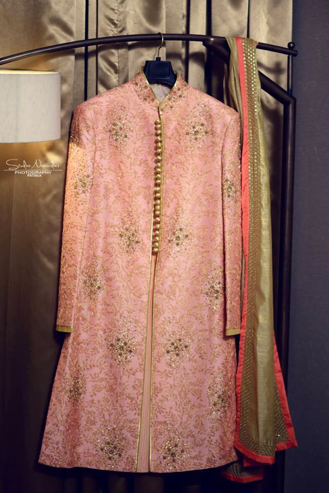 Pastel Pink Sherwani With Inticated Golden Work And Golden Buttons by Sourab Sharma Wedding-photography | Weddings Photos & Ideas