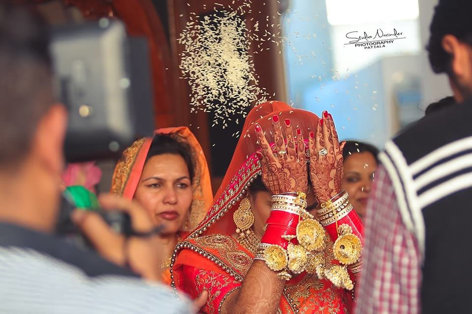 Captivating Glimpse of Bride Performing A Ritual During Vidai by Sourab Sharma Wedding-photography | Weddings Photos & Ideas