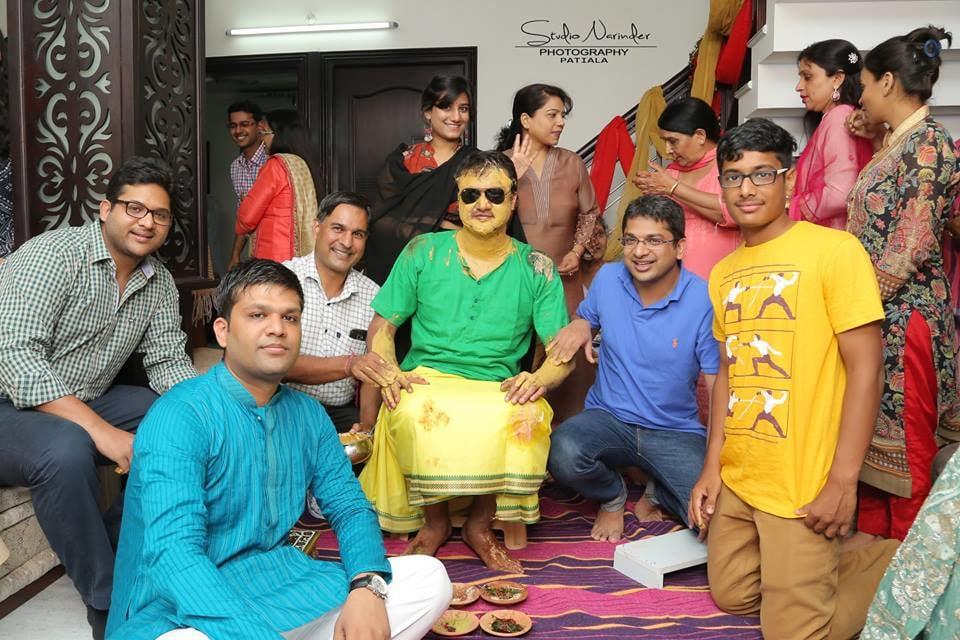 Groom Striking A pose With Family During Haldi Ceremony by Sourab Sharma Wedding-photography | Weddings Photos & Ideas