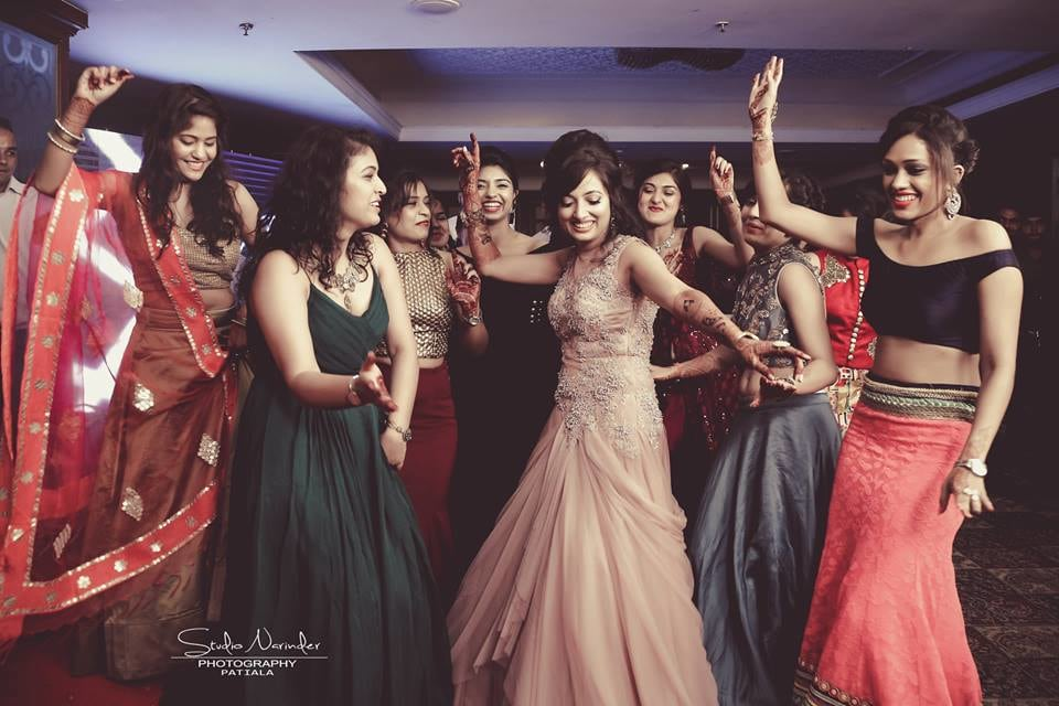 Candid Shot Of Bride With Bridesmaids Amidst Dancing by Sourab Sharma Wedding-photography | Weddings Photos & Ideas