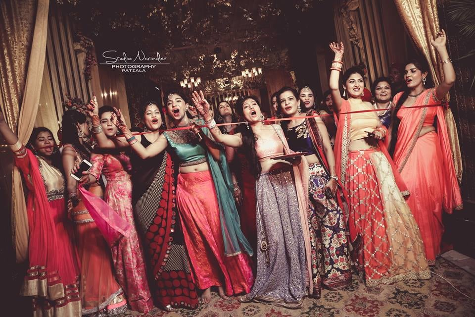 Candid Shot Of Bridesmaids During Ribbon Cutting Ceremony by Sourab Sharma Wedding-photography | Weddings Photos & Ideas
