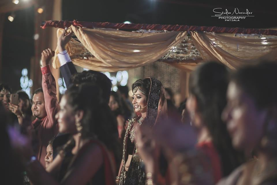 Candid Shot Of Bride Walking Down the Aisle Under Phool Chadar by Sourab Sharma Wedding-photography | Weddings Photos & Ideas