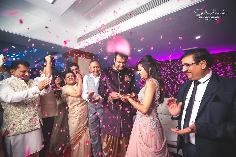 Candid Shot Of Bridegroom Amidst Ring Ceremony Being Showered By Rose Petals by Sourab Sharma Wedding-photography | Weddings Photos & Ideas