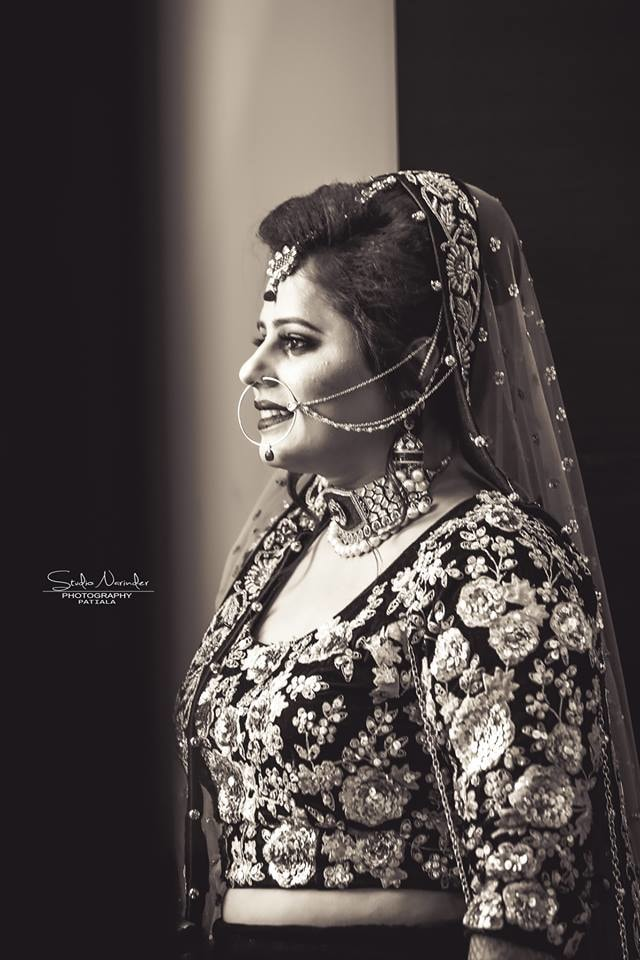 Side Shot Of Bride In Heavy Embroidered Blouse And Accessories by Sourab Sharma Wedding-photography | Weddings Photos & Ideas