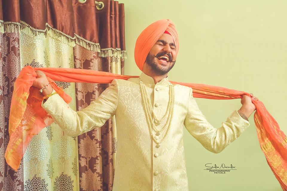 Intricate Off White Sherwani With Pearl Beads Completing Its Look With Orange Turban by Sourab Sharma Wedding-photography Groom-wear-and-accessories | Weddings Photos & Ideas