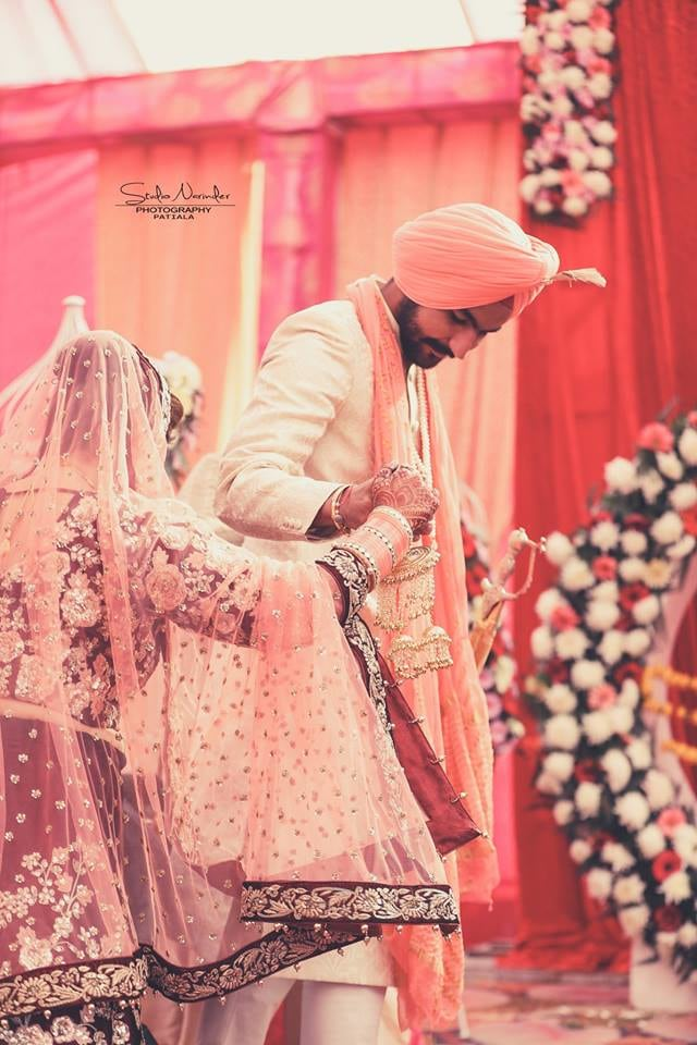 Candid Shot Of Bridegroom Amidst Auspicious Nuptial Round Ceremony by Sourab Sharma Wedding-photography | Weddings Photos & Ideas