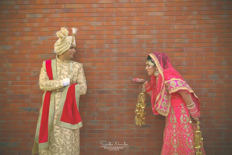 Off White High Collared Sherwani With Golden Leaf Design Completing Its Look By Matching Turban And Red Stole by Sourab Sharma Wedding-photography Groom-wear-and-accessories | Weddings Photos & Ideas