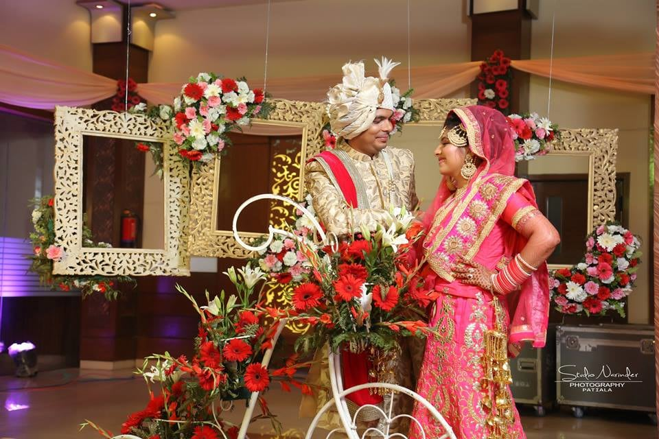 Wedding Shoot Of Bride And Groom In A Flowery Decoration Using Props Like Frames And Bicycle by Sourab Sharma Wedding-photography | Weddings Photos & Ideas
