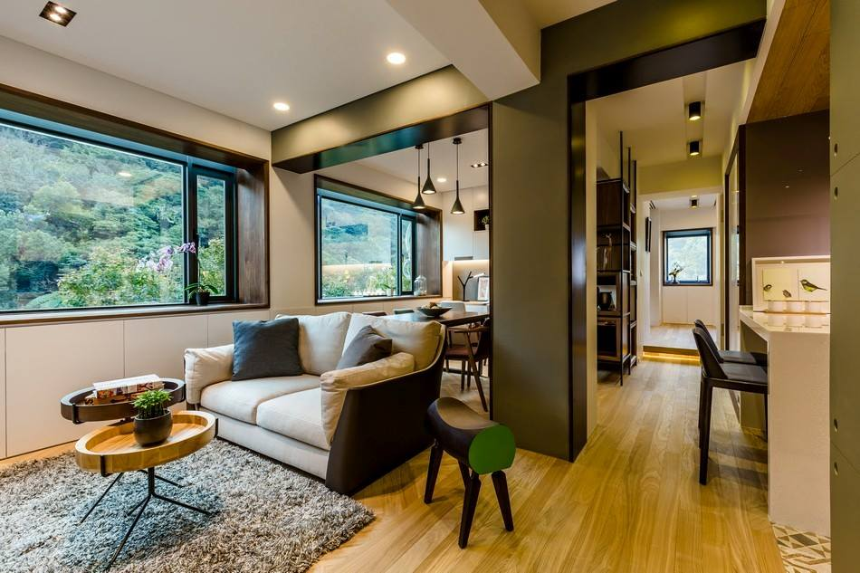 Premium living room with wooden flooring and sectional sofa and ceiling lights by Tanya Anand Living-room Modern | Interior Design Photos & Ideas