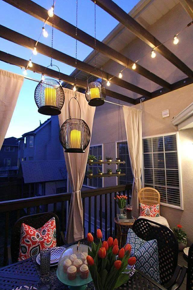 Balcony with sitting area with Chinese lantern and black table and chairs by Tanya Anand Open-spaces Modern | Interior Design Photos & Ideas