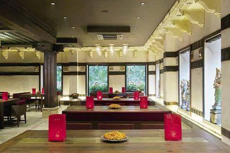 Spacious restaurant with wooden furniture by design101 Contemporary | Interior Design Photos & Ideas