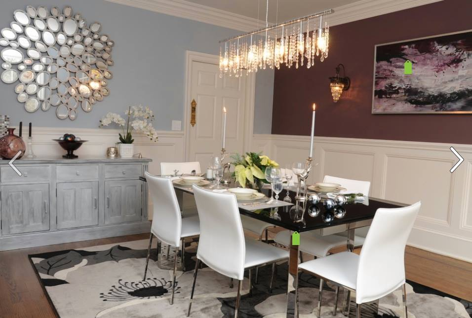 Luxurious dining room setting and granite table top and white chair lit by hanging lights by Tanya Anand Dining-room Modern | Interior Design Photos & Ideas