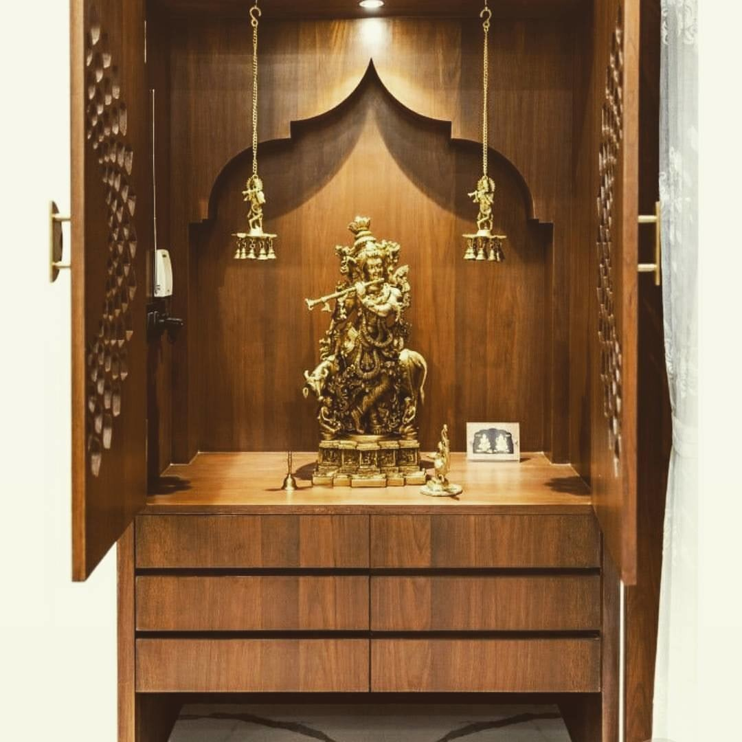 Prayer room with wooden furniture and base drawers by Tanya Anand Indoor-spaces Traditional | Interior Design Photos & Ideas