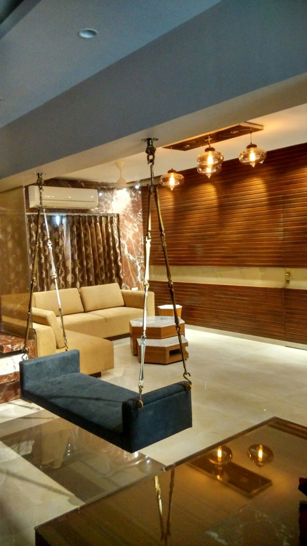 Wood Themed Living Area With Porch Swing by Limited Edition Design Studio Contemporary | Interior Design Photos & Ideas