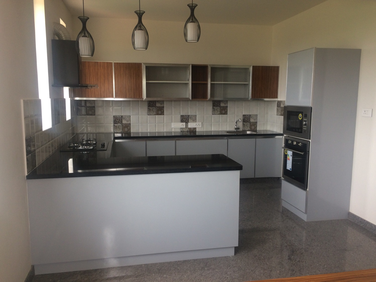 U Shaped White Modular Kitchen Cabinets by JPS Interiors