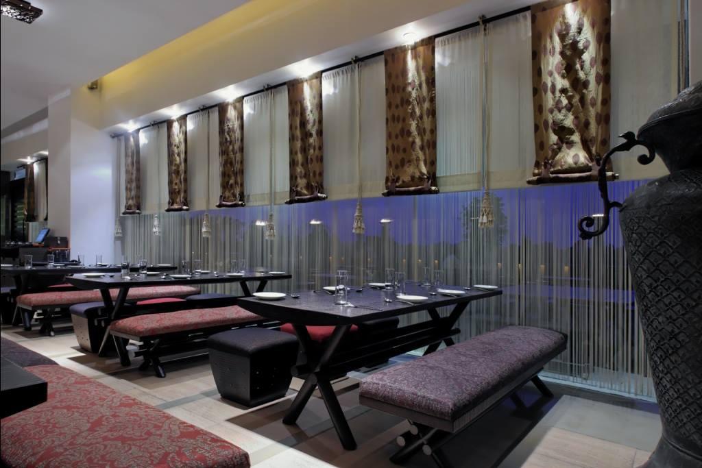 Spacious contemporary restaurant by Midas Dezign - The Golden Touch Contemporary | Interior Design Photos & Ideas