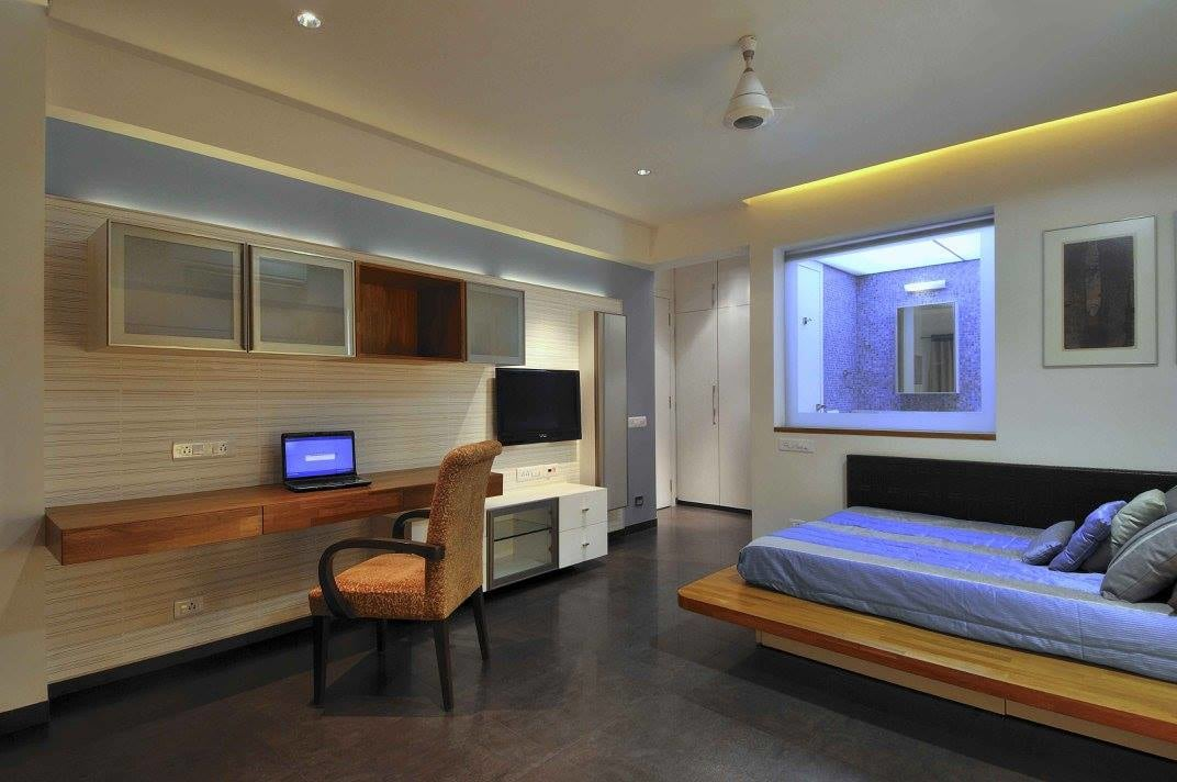 Modern bedroom with tv and marble flooring by Midas Dezign - The Golden Touch Bedroom Modern | Interior Design Photos & Ideas