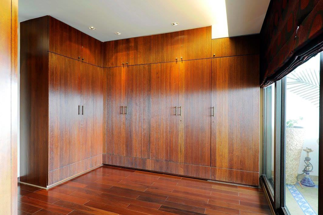 Wooden wardrobe with wooden flooring by Midas Dezign - The Golden Touch Bedroom Contemporary | Interior Design Photos & Ideas